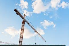 Tower crane under blue sky Stock Photo