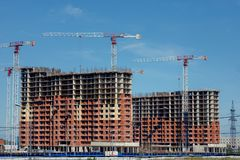 Tower Crane and Unfinished Building Construction Site stock photos
