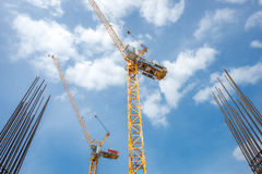 Tower crane - used in construction site with sky and clouds Stock Photo
