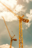 Tower crane - used in construction site with sky and clouds Royalty Free Stock Image