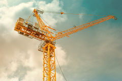 Tower crane - used in construction site with sky and clouds Stock Photography