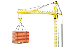 Tower Crane With Stacked Red Bricks Over Wooden Pallet Stock Photo