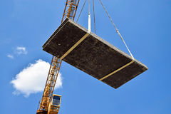 Tower crane is working at the construction site Royalty Free Stock Photo