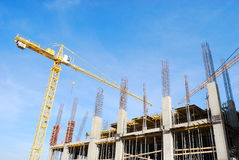 Tower cranes. Two tower cranes over an under construction building Royalty Free Stock Photos