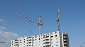 Tower cranes against blue sky stock video footage
