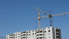 Tower cranes against blue sky stock footage