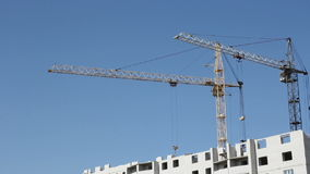 Tower cranes against blue sky Royalty Free Stock Images