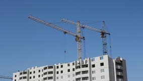 Tower cranes against blue sky Stock Image