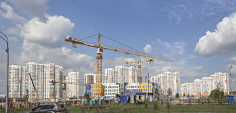 Tower cranes against a residential district. New building Stock Images