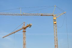 Tower cranes against sky royalty free stock photography