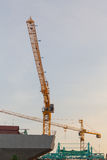 Tower cranes against sky. Royalty Free Stock Photos