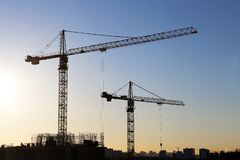 Free Tower Cranes And Construction Site On Sunrise Background Stock Image - 214373471