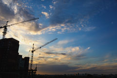 2 tower cranes on a blue sky background Royalty Free Stock Photo