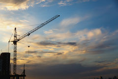 2 tower cranes on a blue sky background Stock Image