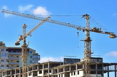 Tower cranes on building Stock Photo