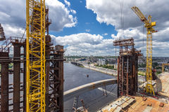 Tower cranes. While building of bridge Royalty Free Stock Image