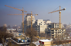 Tower cranes are building building. Large building are building in tower cranes Royalty Free Stock Image