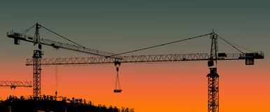 Tower cranes and building silhouette with workers at sunset. Stock Photos