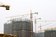 Tower Cranes at Busy Construction Site Stock Photos