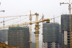 Tower Cranes at Busy construction site Royalty Free Stock Photo