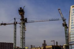 Free Tower Cranes Constructing A New Residential Buildings At A Construction Site. Big Building Construction Concept Stock Image - 196438101