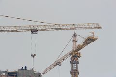 Two tower cranes on the construction of a high-rise building stock photos