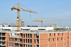 Tower cranes at the construction of a new apartment building stock photos
