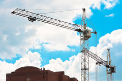 Tower cranes on the construction site Stock Images
