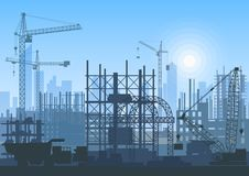 Tower cranes on construction site. Buildings under construction. Royalty Free Stock Photo