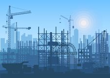 Tower cranes on construction site. Buildings under construction. Royalty Free Stock Image
