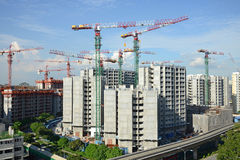Tower Cranes At A Construction Site Royalty Free Stock Photos