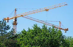 Tower cranes at the construction site stock image
