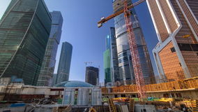 Tower cranes on construction site before skyscrapers timelapse. Moscow, Russia. stock video footage
