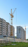 Tower cranes on the construction of two apartment buildings Stock Photography
