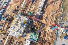 Tower cranes and industrial machinery for building construction. drone photo royalty free stock image
