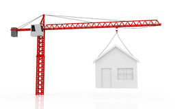 Tower cranes lifting house Stock Photo