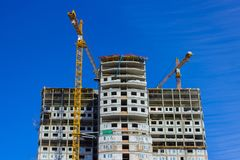Construction of a high-rise building. Huge Crane. Tower cranes and new residential building. Construction of a high-rise building. Huge Crane Royalty Free Stock Photography