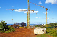 Tower Cranes Operating On Construction Site Stock Photography
