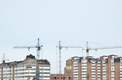 Tower cranes in operation. Natural colors and real photos stock images