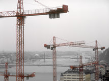Tower cranes over a Budapest. Stock Photo