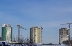 Tower cranes and reinforced buildings under construction Royalty Free Stock Photo