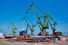 Tower cranes at shipyard Gdansk. Tower cranes at shipyard Stocznia Gdanska Royalty Free Stock Photo
