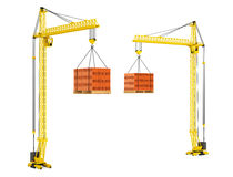 Tower Cranes with Stacked Red Bricks over wooden Pallet Royalty Free Stock Images