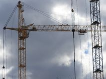 Tower cranes and their parts, construction of a new house royalty free stock image