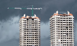Tower cranes and two construction building Stock Images