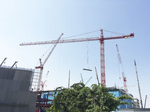 Tower Cranes working on construction site. Royalty Free Stock Image