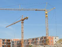 Tower cranes works at the construction site stock photo