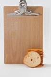 Tower of crispy toasted toast and wooden board Royalty Free Stock Images