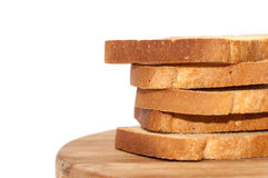 Tower of crunchy bread toast on the wooden board Stock Photography