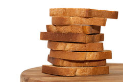 Tower of crunchy bread toast on the wooden board Royalty Free Stock Photos